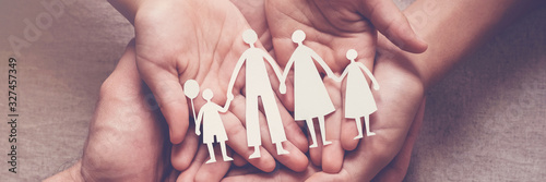 Fotomural Adult and children hands holding paper family cutout, family home, adoption, fos