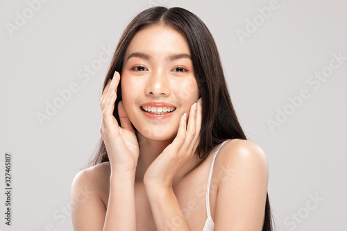 Fototapety, obrazy: Beautiful Asian woman touching soft cheek smile with clean and fresh skin Happiness and cheerful with positive emotional,isolated on white background,Beauty and Cosmetics Concept