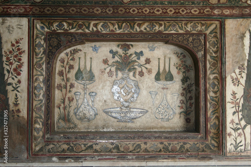 Agra, Uttar Pradesh / India - February 27, 2012 : An inlaid work of color stone on white marble at Itimad-Ud-Daulah in Agra Fototapeta