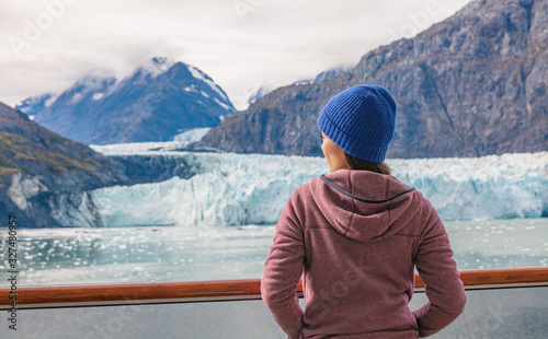 obraz PCV Alaska cruise inside passage to Glacier bay National Park woman tourist relaxing on deck watching landscape nature background in spring with melting ice. Scenic cruise vacation trave.