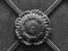 Round Black Iron Decoration On The Metal Door Or Gate Of Old Christian Church Or Cathedral