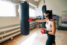 Female Boxer Hitting A Huge Pu...