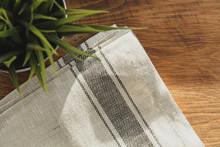 Striped Linen Napkin On Wooden...