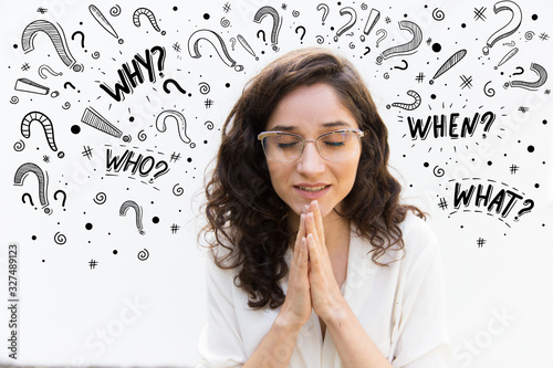 Beautiful woman in eyeglasses praying with closed eyes Wallpaper Mural