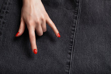 A Woman Hand With A Red Manicu...