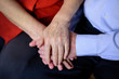 Two hands of an old couple, lying upon each other
