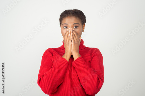 Fototapeta Surprised young woman covering mouth
