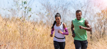 Happy African Couple Jogging I...