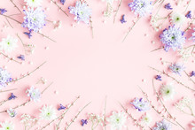 Flowers Composition. White And Purple Flowers On Pink Background. Spring Concept. Flat Lay, Top View, Copy Space