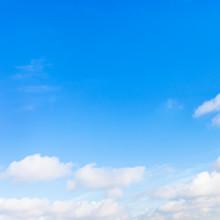 Low Little Clouds In Blue Sky
