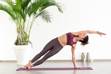 Woman Doing Side Plank Pose In...
