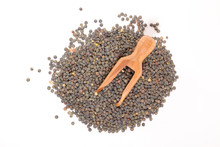 Green Lentils- Raw Legume And Wooden Spoon Isolated On White Background