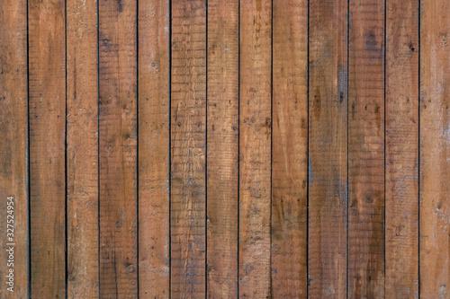 Fototapeta Rustic wooden fence with vertical planks, brown background obraz na płótnie