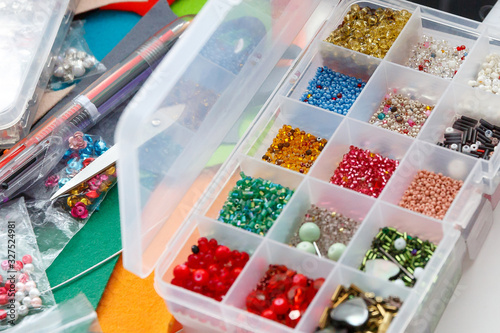 Photo workspace, container with beads of different colors
