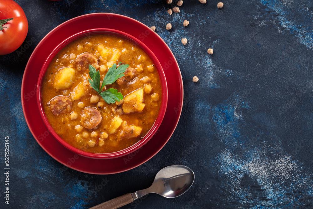 Fototapeta Chickpea stew with chorizo and potatoes