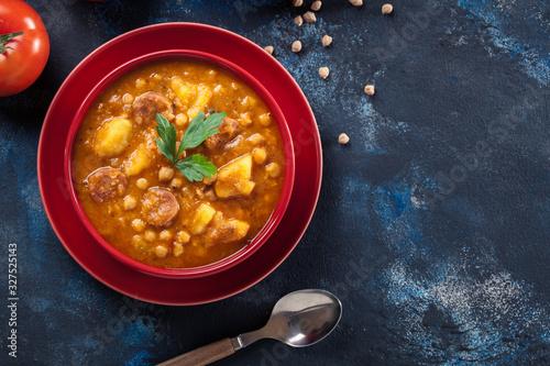 Fototapeta Chickpea stew with chorizo and potatoes obraz