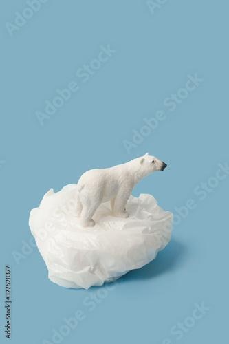 Papel de parede White polar bear on plastic bag on blue background, plastic pollution and climat