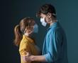 Leinwanddruck Bild - Young loving couple wearing face masks