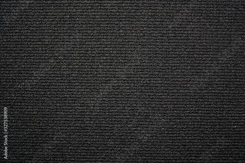 Foto Black background carpet with small horizontal stripes