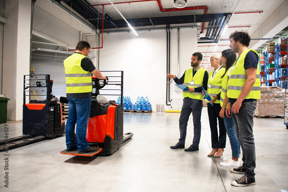 Fototapeta Training on a forklift, managers and workers