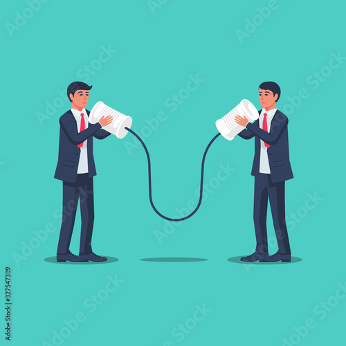 Businessmen communicate using tin cans. Business communication concept. Vector illustration flat design. Isolated on background. People talking on can phone. Discussion of questions.