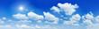 Leinwandbild Motiv Blue sky, white clouds and shining sun