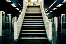 Man At The Top Of Stairways In...