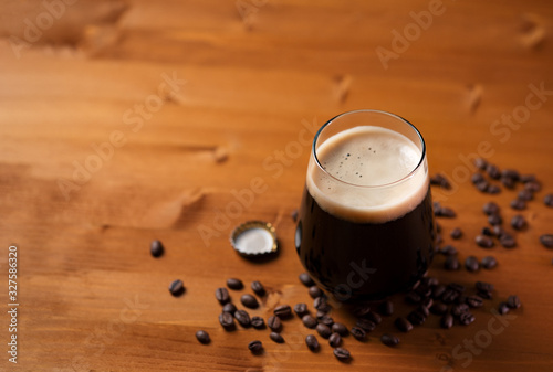Craft beer coffee stout in a glass on a wooden table Canvas Print