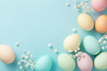 Pastel Easter Eggs On Blue Background Top View. Flat Lay Style..