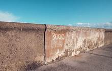 Cleveleys Lancshire Seafront Flood Defence Wall System. Sea Defence Sea Levels Rising, Climate Change. Security Concrete Ramps And Curves Sea Wall. Outdated Ocean Defences.