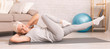 Leinwanddruck Bild - Active senior woman exercising on floor at home, panorama