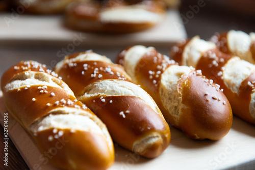Closeup photo of lye bun and bavarian pretzel in bakery Tapéta, Fotótapéta
