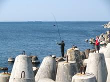BALTIYSK, RUSSIA. Fishing On The Baltic Sea With Tetrapods
