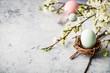 Leinwanddruck Bild - Easter composition on grey concrete backgrount