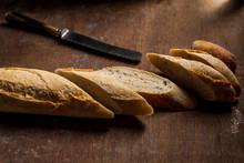 Baguette Sliced On Dark, Woode...