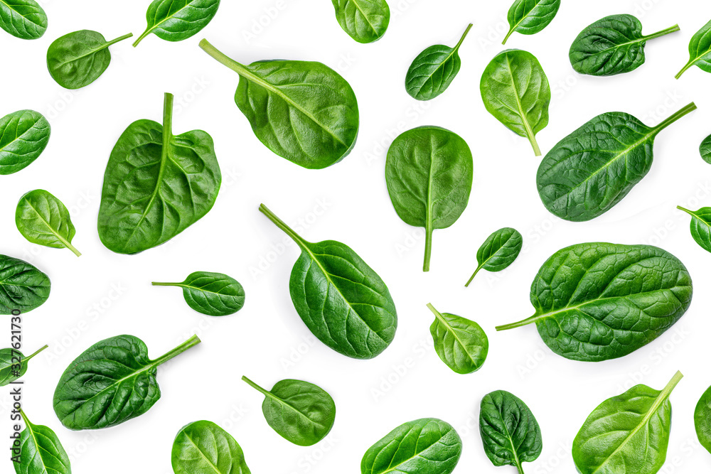 Fototapeta Spinach Pattern. Creative layout made of spinach leaves isolated on white background. Flat lay. Healthy Food concept.