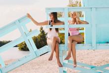 Two Carefree Women Friends Dri...
