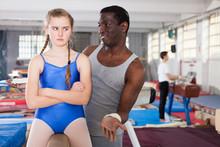 Coach Comforting Sad Teenage Girl