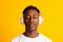 Happy African American Man Listening To Music