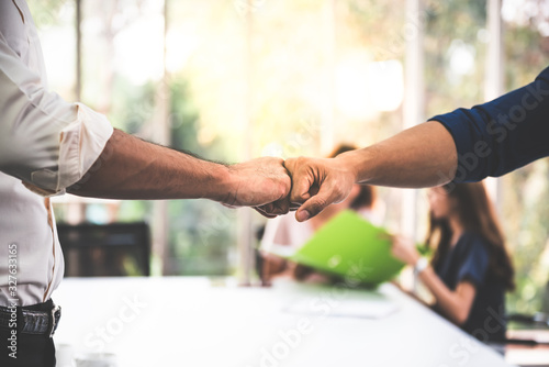Close up images, the hand of Business men Fist bump with blurred of business wom Wallpaper Mural
