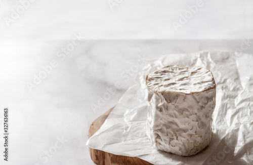 Homemade farm goat cheese on white beeswax wraps paper marble background with copy space Canvas Print