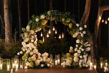 Evening Wedding Ceremony With Garlands Of Lamps