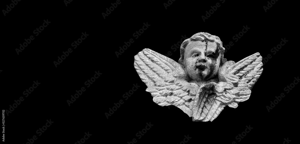 Close up of angel with wings. Vintage ancient stone statue isolated on black background <span>plik: #327639702 | autor: zwiebackesser</span>