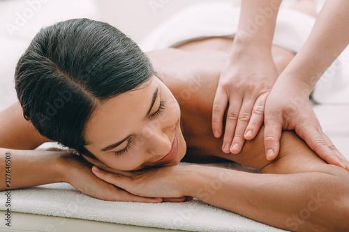 Beautiful woman enjoying massage at the spa. Tapéta, Fotótapéta