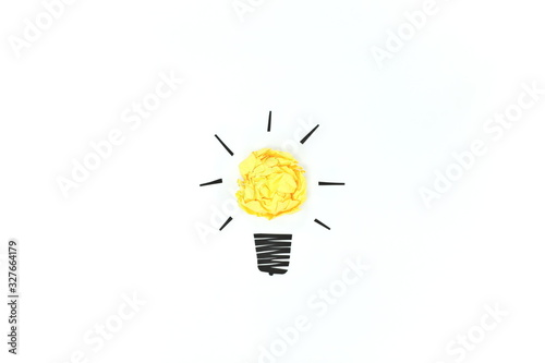Fototapeta Yellow crumpled paper light bulb isolated in white background. Creativity and innovation concept. obraz na płótnie