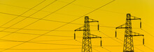 Electric Power Industry. Transmission Towers Or Electricity Pylons With Golden Sky Background