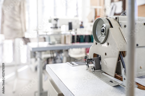 Modern sewing equipment in tailor workshop Canvas Print