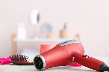 Modern hair dryer on table in salon