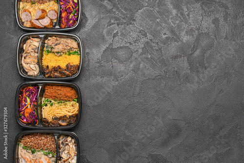 Fototapeta Containers with healthy food on dark background obraz