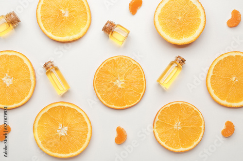 Composition with citrus essential oils on white background